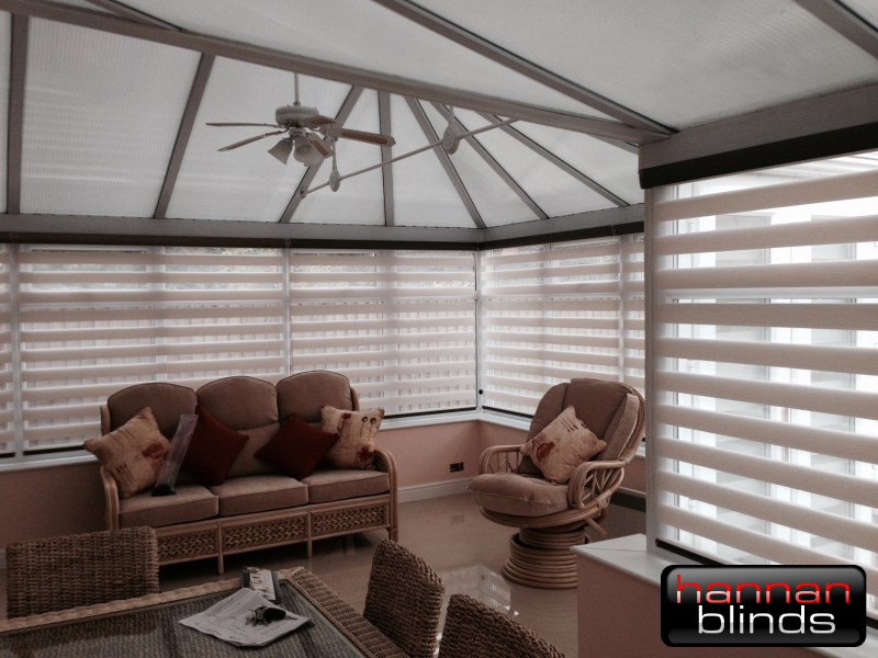 Stunning Mirage Day & Night Blinds with Black cassettes in a Conservatory