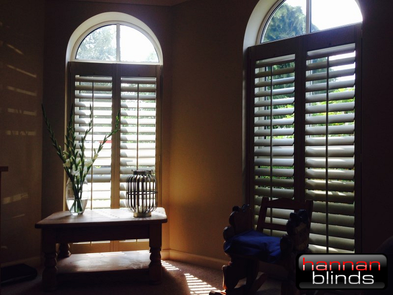 Full Height Shutters in Tall Arched Windows