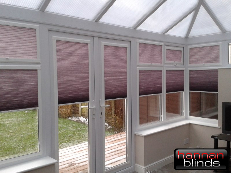 Purple Perfect Fit Pleated Blinds in a Conservatory