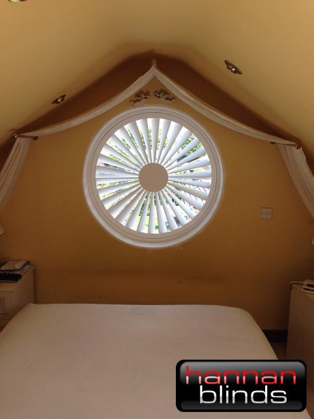 Circular Shutter for Unusual Shaped Window in Bedroom