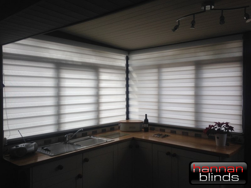 Day & Night Blinds in a Corner Window of a Kitchen