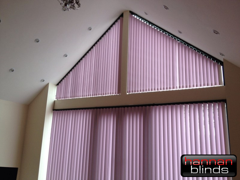 Sloping Vertical Blinds in a Tall Window