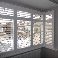 Clean horizontal lines make for a contemporary style in square bay windows